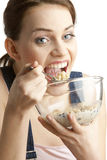 Woman eating cereals Stock Photos