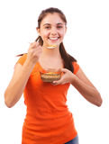 Woman eating cereals. Portrait of young caucasian girl eating cereals, isolated over white background Stock Photo