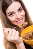 Woman eating cereals Royalty Free Stock Photos