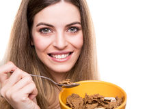 Woman eating cereals Royalty Free Stock Photography