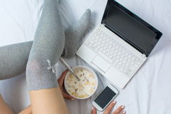 Woman eating cereals in bed Stock Photo