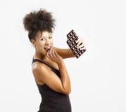 Woman eating chcolate stock photos