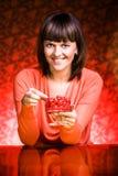 Woman eating cherries Stock Photo