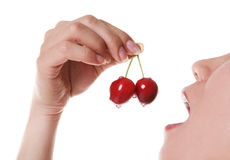 Woman Eating Cherries Stock Photos