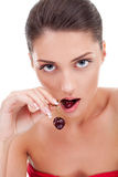 Woman eating cherry. Closeup portrait of young beautiful woman eating cherry in her lips and hand Royalty Free Stock Photo