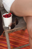 Woman eating cherry Stock Images