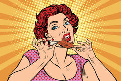 Woman eating a chicken leg. Pop art retro comic book illustration. Restaurant and fast food, homemade food Stock Photo