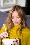 Woman Eating Chinese Food. Skin was smoothen, no noise reduction or sharpen used Royalty Free Stock Image