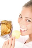 Woman eating chips Royalty Free Stock Images