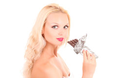 woman eating chocolate Royalty Free Stock Images