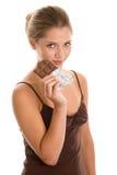 Woman eating chocolate stock photography