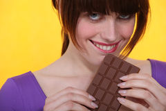Woman eating chocolate Royalty Free Stock Photo