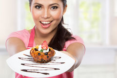 Woman eating chocolate cake Royalty Free Stock Images