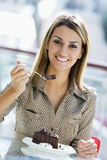 Woman eating chocolate cake in cafe Royalty Free Stock Photo