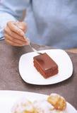 Woman eating chocolate cake Stock Image