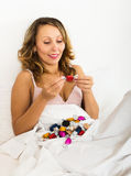 Woman eating chocolate candy Stock Image