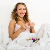 Woman eating chocolate candy and smiling Stock Photo