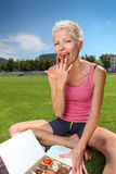 Woman eating chocolate candy after workout Stock Photography
