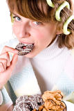 Woman eating chocolate chip cookies Royalty Free Stock Photos
