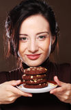 Woman eating chocolate chip cookies Royalty Free Stock Image