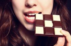 Woman eating chocolate Stock Photo