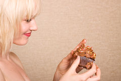 Woman eating chocolate cupcake Stock Photo