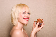 Woman eating chocolate cupcake Royalty Free Stock Photography