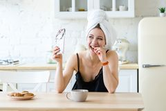 Woman eating chocolate and enjoying after keeping Diet. Cheat meal royalty free stock images