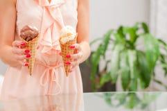 Woman eating chocolate ice cream cone. Stock Photography