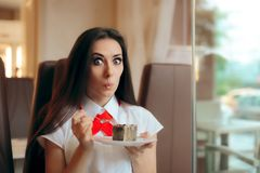 Woman Eating Chocolate Souffle in a Confectionery Shop. Cute office girl snaking in lunch break at a sweetshop Royalty Free Stock Photo