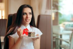 Woman Eating Chocolate Souffle in a Confectionery Shop. Cute office girl snaking in lunch break at a sweetshop Stock Image