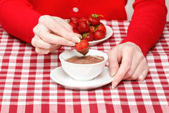 Woman eating chocolate strawberry fondue Royalty Free Stock Images
