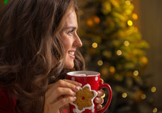 Woman eating christmas snacks near christmas tree Royalty Free Stock Images