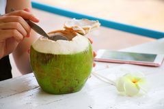 Woman is eating coconut Stock Images
