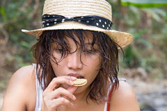 Woman eating cookie Royalty Free Stock Photos