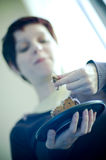 Woman eating cookies Royalty Free Stock Images