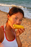 Woman eating corn Royalty Free Stock Images