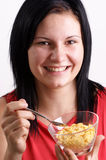 woman eating corn flakes from a bowl Royalty Free Stock Photo