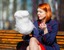 Woman eating cotton candy Royalty Free Stock Photo