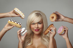 Woman eating cream cakes Royalty Free Stock Photo
