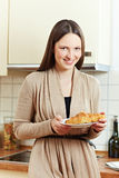 Woman eating a croissant Stock Photo