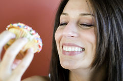 Woman eating cup cake Stock Photo