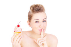Woman eating cupcake in secret Stock Photography