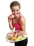 Woman eating cupcake and smiling Stock Photo