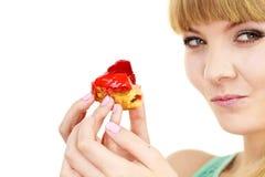 Woman eating cupcake sweet food Stock Images