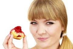 Woman eating cupcake sweet food Stock Photos