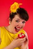 Woman eating cupcakes Royalty Free Stock Image