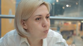 Woman eating a delicious cake with a fork in the restaurant.  stock video footage