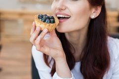 Woman eating delicious dessert Royalty Free Stock Image