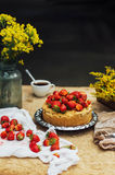 Woman eating a delicious home-made cake with aisheny and stuffed strawberries for dessert. Summer Styled dinner table. Coffee to t Royalty Free Stock Photography
